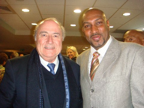 Photo: Sport Minister Anil Roberts (right) poses with FIFA President Sepp Blatter. The Sport Minister's accounting has not met the approval of the Auditor General.