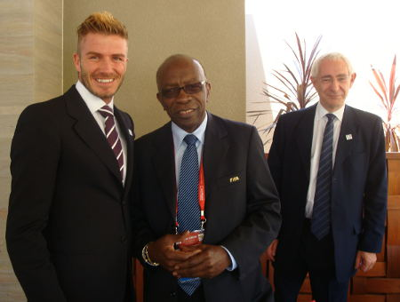Ex-FIFA VP and MP Jack Warner (centre) is flanked by former England football captain David Beckham (left) and ex-FA chairman Lord David Triesman.