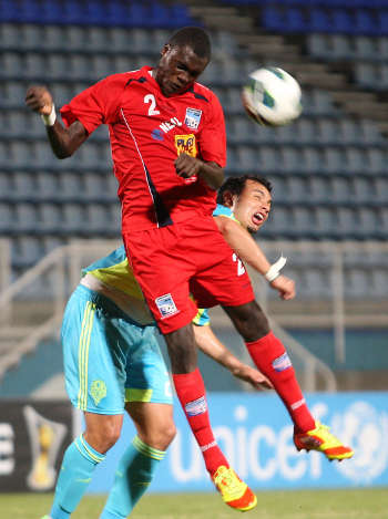 Photo: Caledonia AIA defender Aubrey David wins a header against Seattle Sounders in the 2012 CONCACAF Champions League. (Courtesy Wired868)