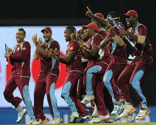 Photo: Sunil Narine (far lest) and the West Indies team celebrate their World T20 success in 2012. (Courtesy khelnama.com)