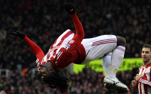 Photo: Trinidad and Tobago attacker Kenwyne Jones jumps for joy during his spell with Stoke City. (Courtesy Ross Kinnaird/ Getty Images)