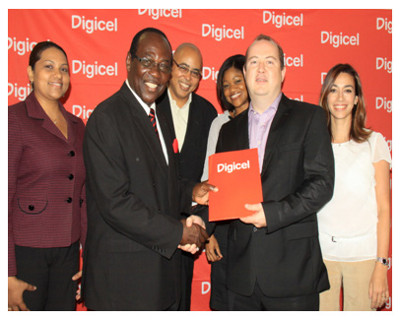 Photo: Digicel CEO Niall Dorrian (second from right) congratulates Caribbean Prestige Foundation (CPF) executive chairman William Munro (second from left). Munro has possibly won every International Soca Monarch competition since 1993. (Courtesy SocaMonarch.net)