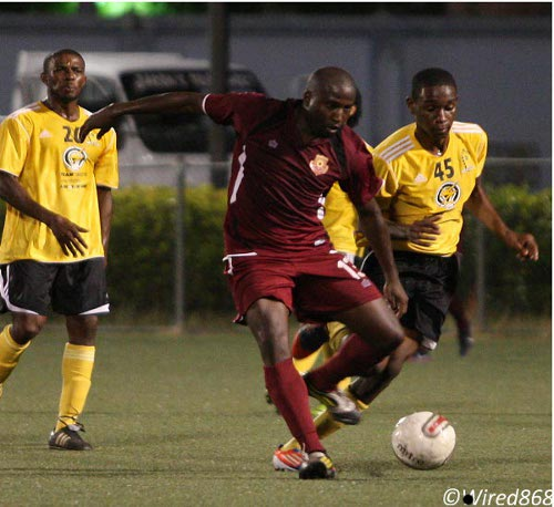 Photo: North East Stars striker Cornell Glen (centre) in action during a clash with T&TEC FC. (Courtesy Wired868)