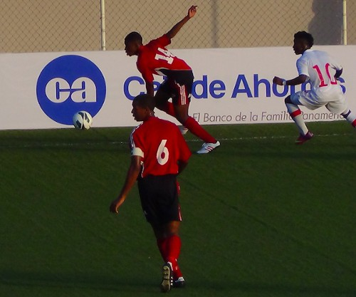 Photo: Trinidad and Tobago national under-17 midfielder Andre Fortune (background) is supported by his captain Brendon Creed (number six) during their opening CONCACAF match against Canada. (Courtesy TTFF Media)
