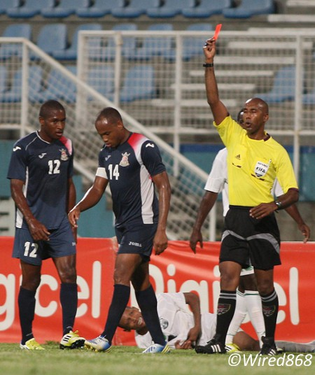 Photo: Defence Force captain Corey Rivers (centre) is sent off by referee Neil Brizan while teammate Josimar Belgrave (left) looks on. In the back ground is W Connection victim Stefano Rijssel. (Courtesy Wired868)
