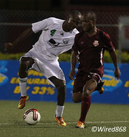Photo: W Connection defender Daneil Cyrus (left) keeps an eye on Stars flanker Kennedy Hinkson. (Courtesy Wired868)