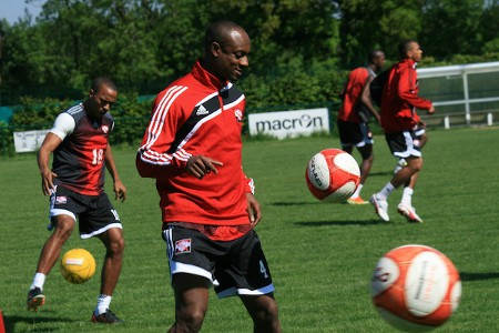 Photo: Mllwall defender Justin Hoyte (centre) made his international debut for Trinidad and Tobago against Romania in June 2013. (Courtesy Shaun Fuentes/TTFF Media)