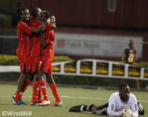 Photo: St Ann's Rangers and Trinidad and Tobago national goalkeeper Jan-Michael Williams (right) has a rough day at the office against Caledonia AIA. (Courtesy Wired868)