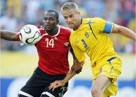 Photo: Trinidad and Tobago's all-time leading scorer Stern John (left) tussles with Sweden captain Olof Mellberg during the 2006 World Cup in Dortmund, Germany. (Courtesy FIFA.com)