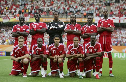 Photo: Chris Birchall (far left and stooping) and the Trinidad and Tobago national football team poses before kick off against England at the 2006 World Cup. (Courtesy 90soccer.com)