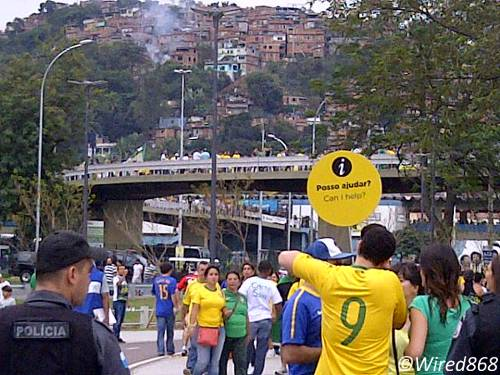 Photo: Brazil football fans head to see their national team play in the 2013 FIFA Confederations Cup final. Many in the favelas (in the background) have bigger problems.