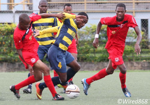 Photo: Club Sando midfielder Anthony Parris (centre) takes on the Joe Public defence during a Super League contest. (Courtesy Wired868)