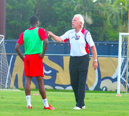 Photo: Trinidad and Tobago director of football Leo Beenhakker (right) makes a point to utility player Joevin Jones during training. (Courtesy TTFA Media)