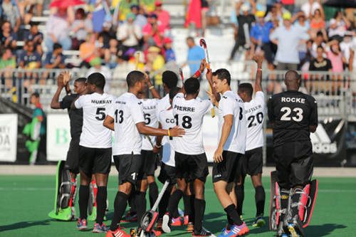 Photo: The Trinidad and Tobago national hockey team celebrate beating the United States to third at the 2013 Pan American Cup. (Courtesy Panamhockey.org)