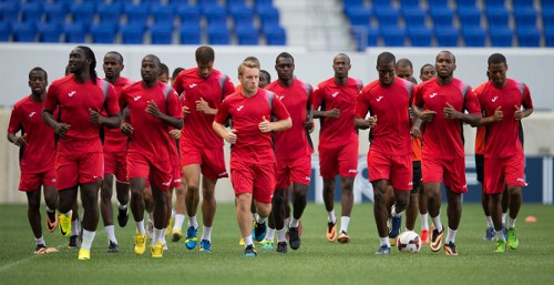 Photo: The Trinidad and Tobago senior national football team warms up at the 2013 CONCACAF Gold Cup. (Courtesy CONCACAF)