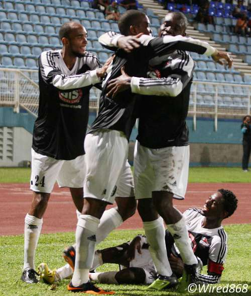 Photo: Central FC strikers Dwight Quintero (second from left) and Rundell Winchester (second from right) share the love while Akeem Benjamin (far left) and Jason Marcano join in. (Courtesy Wired868)