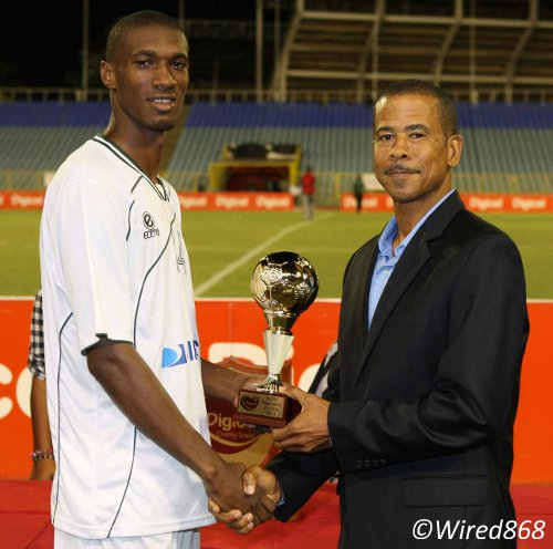 Photo: W Connection attacker Hasim Arcia (left) is rewarded by Pro League CEO Dexter Skeene for a  MVP performance in the Digicel Charity Shield. (Courtesy Wired868)