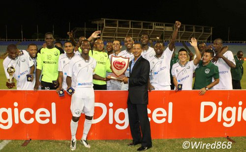Photo: DIRECTV W Connection captain Silvio Spann (centre) collects the Digicel Charity Shield award from Pro League CEO Dexter Skeene. (Courtesy Wired868)