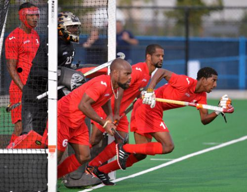 Photo: The Trinidad and Tobago national men's hockey team in action at the 2013 Pan American Cup. T&T took bronze despite almost missing the competition due to late funding from the Ministry of Sport. (Courtesy panamhockey.org)