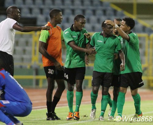 Photo: San Juan Jabloteh attacker Rennie Britto (third from right) is congratulated by his teammates after helping to engineer an unlikely recovery against St Ann's Rangers. (Courtesy Wired868)
