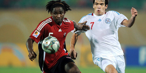 Photo: Former Trinidad and Tobago FIFA World Youth Cup defender Akeem Adams (left).