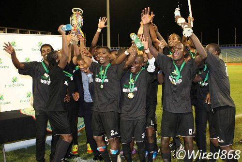 Photo: Central FC players celebrate their first silverware after edging Defence Force 2-1 in the First Citizens Cup final. (Courtesy Wired868)