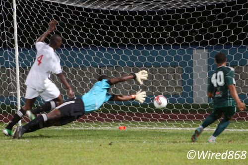 Photo: W Connection attacker Shahdon Winchester (right) drives past Central custodian Marvin Phillip (centre) while Omar Charles tries to help during the 2012/13 season. Winchester is now on loan at Finnish team FF Jaro while Phillip has joined Point Fortin Civic. (Courtesy Wired868)