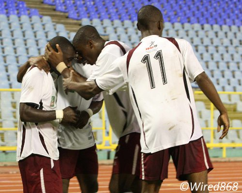 Photo: North East Stars striker Trevin Caesar (far left) is congratulated by his teammates after scoring a hattrick against defending champion team, Defence Force. (Courtesy Wired868)