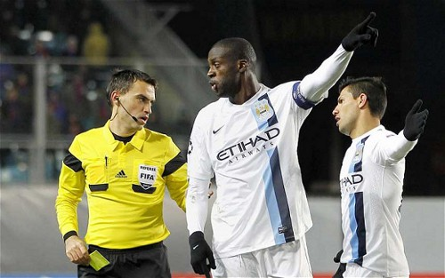 Photo: Manchester City and Ivory Coast football star Yaya Toure (centre) and teammate Sergio Aguero (right) call the referee's attention to racist chanting from the stands in Moscow. (Courtesy TheTelegraph.co.uk)