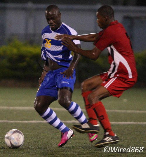Photo: Defence Force forward Richard Roy (left) scored twice against 1976 FC Phoenix in Toyota Classic action last night. (Courtesy Wired868)