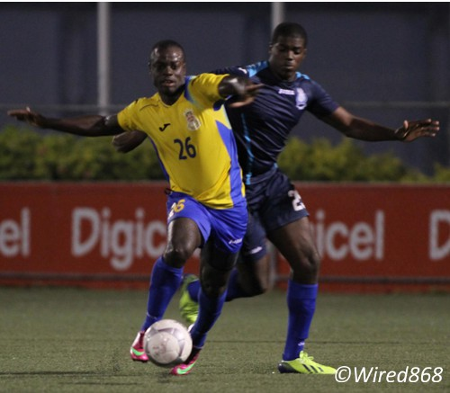 Photo: Defence Force forward Richard Roy (left) takes on Police defender Kemron Purcell at Macoya yesterday. (Courtesy Wired868)