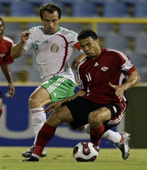 Photo: Trinidad and Tobago midfielder Carlos Edwards (right) in action against Mexico.