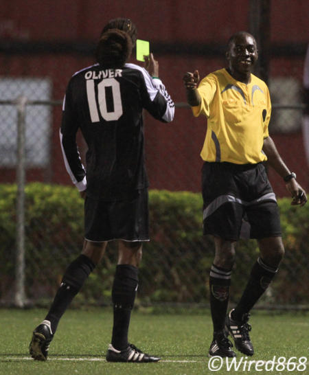 Photo: Central FC playmaker Marvin Oliver (left) and referee Gyasi McDonald share a light moment during Central's 3-0 win over Joe Public. (Courtesy Allan V Crane/ Wired868)