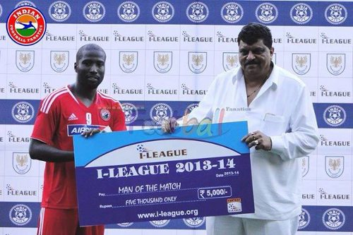 Photo: Trinidad and Tobago striker Cornell Glen (left) receives a Man of the Match award after a good day at the office for Shillong Lajong.