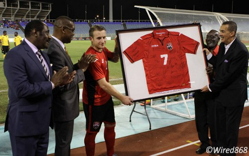 "Photo: ""Soca Warriors"" midfielder Chris Birchall (centre) receives a token of appreciation from Trinidad and Tobago president Anthony Carmona (far right). Looking on is Jamaica Football Federation (JFF) president Horace Burrell (far left), Trinidad and Tobago Football Association (TTFA) president Raymond Tim Kee (second from left) and  TTFA official Carl Joseph. (Courtesy Wired868)"