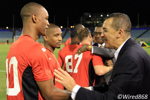 "Photo: Trinidad and Tobago president Anthony Carmona (far right) offers a reassuring gesture to ""Soca Warrior"" Ataullah Guerra. (Courtesy Allan V Crane/Wired868)"
