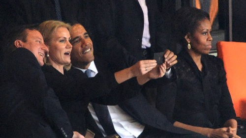 "Photo: United States President Barack Obama (second from right) poses for a ""selfie"" with Britain Prime Minister David Cameron (far left) and Denmark Prime Minister Helle Thorning-Schmidt (second from left) while US First Lady Michelle Obama tries to remember the nuclear warhead codes. (Courtesy CNN)"