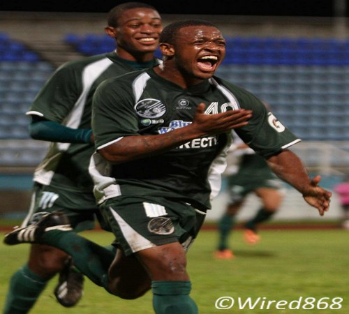 Photo: W Connection midfielder Jomal Williams (right) celebrates the opening TTFA FA Trophy goal. (Courtesy Wired868)