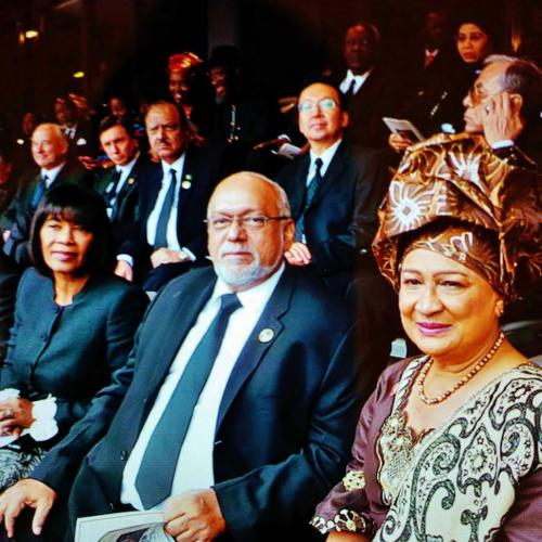 Photo: How did you all get here? Somehow, Jamaica Prime Minister Portia Simpson-Miller (left) and Guyana President Donald Ramotar (centre) managed to get to South Africa without a private jet or a wardrobe malfunction. (Courtesy Trinidad Express)
