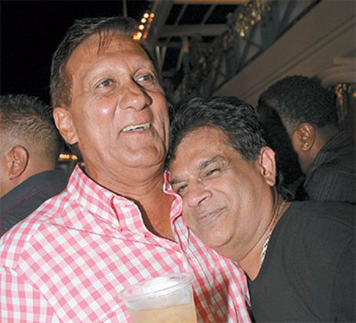 Photo: Health Minister Dr Fuad Khan (right) shares a tender moment with UNC financier Ish Galbaransingh who is wanted for corruption by the United States Government.