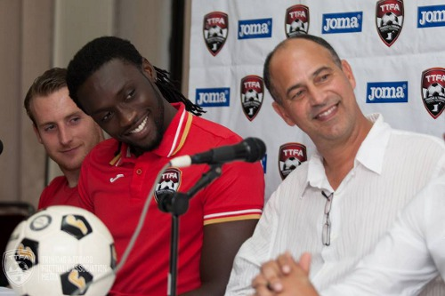 Photo: Trinidad and Tobago captain Kenwyne Jones (centre) and head coach Stephen Hart (right) have a laugh at a press conference alongside Chris Birchall. (Courtesy TTFA Media)
