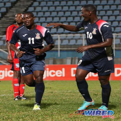 Photo: Late Defence Force winger Kevon Carter (left) is congratulated by teammate Devorn Jorsling after scoring against Caledonia AIA in the 2012/13 season. Jorsling and Carter were close friends and combined successfully for club and country. (Courtesy Wired868)