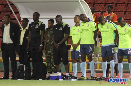 Photo: The Defence Force team observed a minute's silence for fallen teammate Rawle Fletcher before a Pro League match against W Connection on 3 January 2014. (Courtesy Wired868)