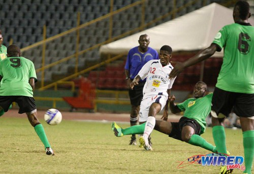 "Photo: San Juan Jabloteh midfielder Jevon Morris (second from right) tackles Caledonia AIA debutante Jameel ""Shoter"" Neptune (centre). Looking on are Jabloteh players Dario Holmes (far right) and Jelani Felix (far left). (Courtesy Wired868)"