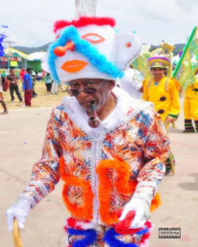 Photo: A masquerader plays the traditional sailor mas for Carnival. (Courtesy Marshe)