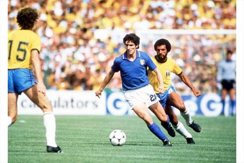 Photo: Italy forward Paolo Rossi (centre) tries to evade the attentions of Brazil defender Junior (right) during the 1982 World Cup. (Courtesy FIFA)