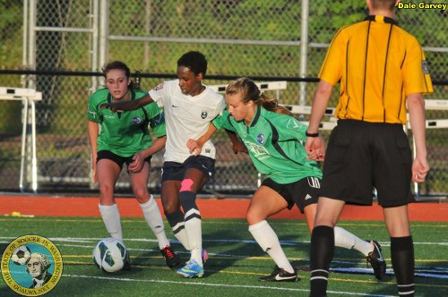 Photo: Seattle Reign FC Reserve forward Kennya Cordner (centre) weaves her way past two Emerald City defenders in Women's Premier Soccer League action in the US. (Courtesy Goalwa)