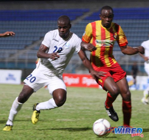 Photo: Police utility player Elijah Belgrave (left) and Point Fortin Civic defender Andre Ettienne. (Courtesy Wired868)