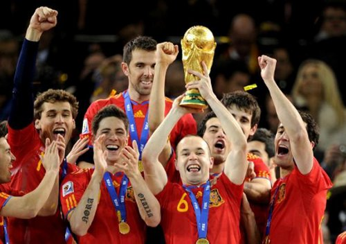 Photo: The Spain national football team celebrates with the 2010 World Cup trophy.