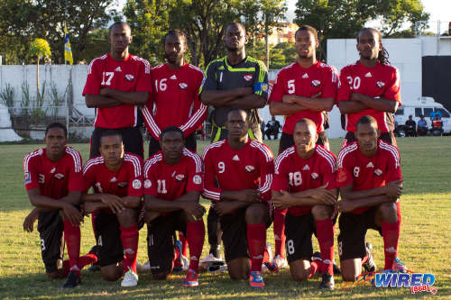 Photo: The Trinidad and Tobago football team prepares to face Martinique in the 2012 Caribbean Cup semifinals. Kevon Carter is third from left in the front row. (Courtesy Allan V Crane/ Wired868)